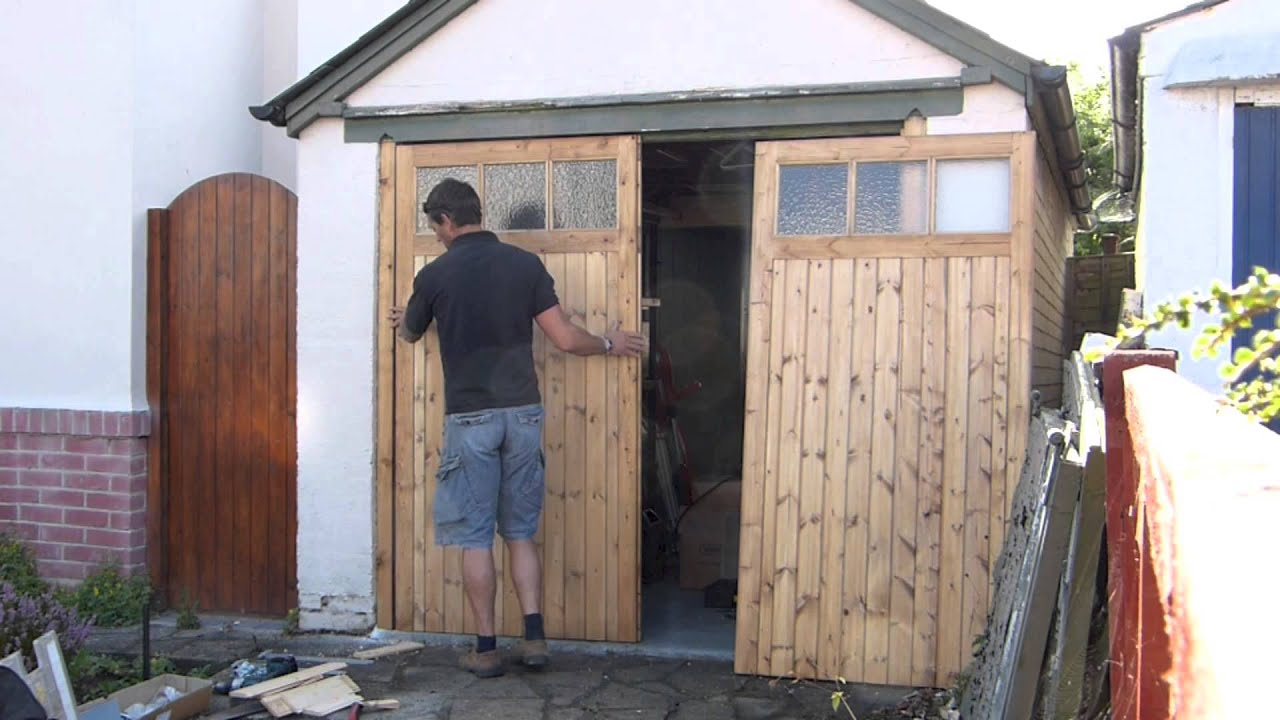 Wooden Garage Door Makers - YouTube