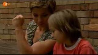 Claudia Schmutzler flexing her biceps