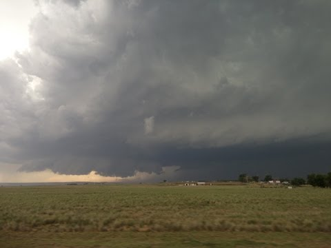 Supercell, rapidly rotating wall cloud, and brief tornado W of Hawk Springs, WY