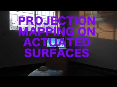 Projection mapping on actuated surfaces