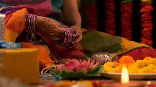 Woman / female arranging bangles for her wedding celebration - Festive Environment