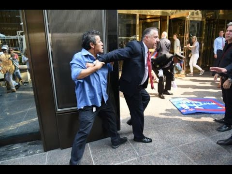 Donald Trump Security Guard Hits Protester in Face after Taking Banner