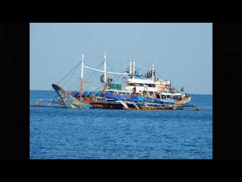Typical Pilipino Outrigger Fishing Boat With Small Boat