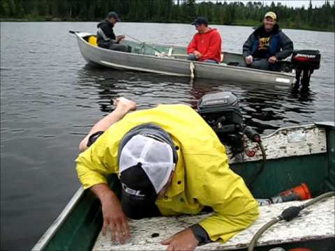 fat man falls out of boat.wmv