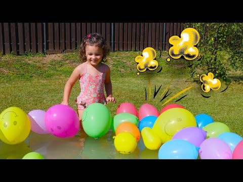 Worlds Biggest Balloon Pool with Kinder Surprise eggs hidden in the Balloons!