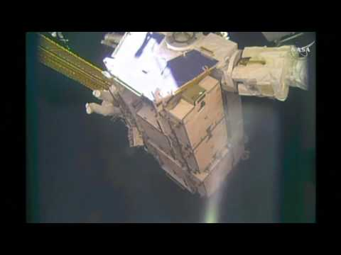 Astronauts venture outside ISS to replace batteries