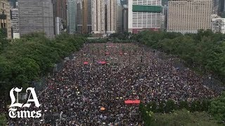 Rally at Victoria Park in Hong Kong attracts hundreds of thousands