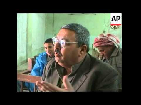 Anti- and pro-Saddam demos, Iraqis watch Saddam trial on TV