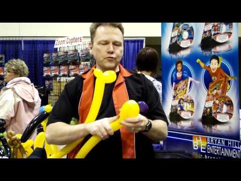 Omaha balloon artist TomTheBalloonGuy teaches how to make an alien