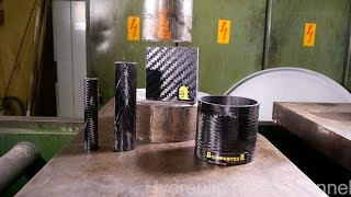 Crushing carbon fiber with hydraulic press