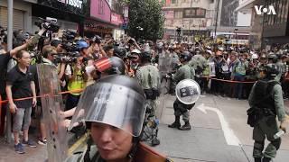 """香港民众举行""""全球反极权""""示威 警方强力遏阻"""