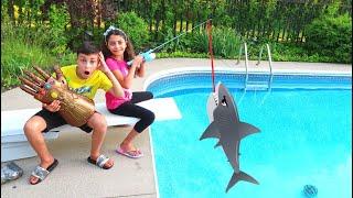 Heidi and Zidane Pretend Play Fishing for Toy Shark