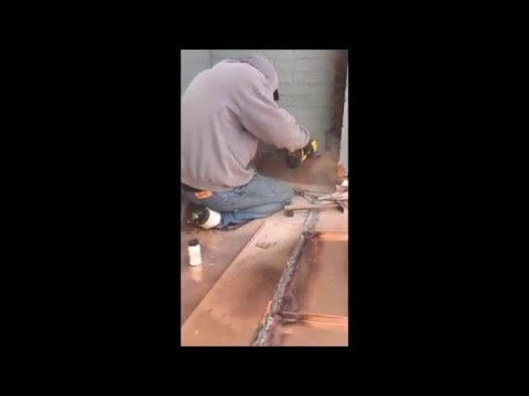 RickJohn Roofing - Cutting a reglet to install counter flashing