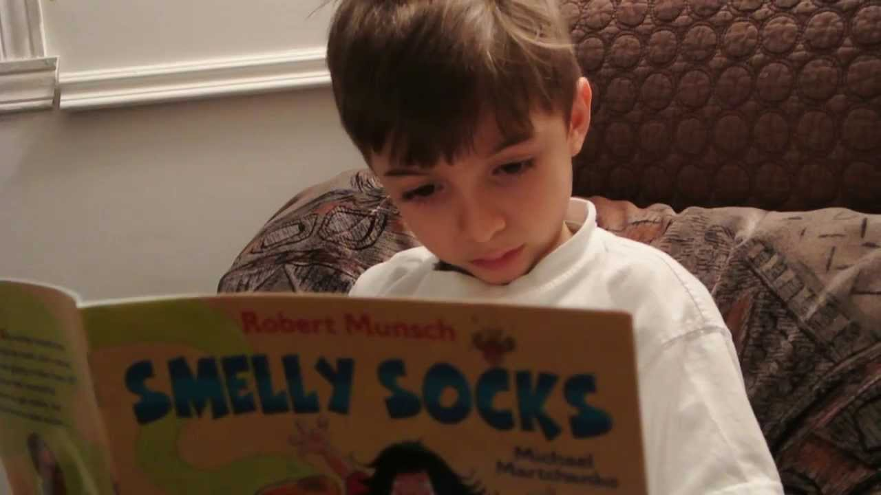 6 Year Old Reading Robert Munsch Smelly Socks