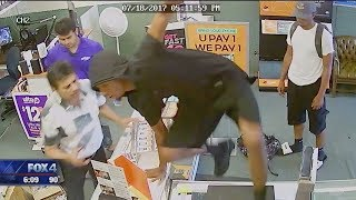 GREAT VIDEO:  Arlington clerks fight off robbers