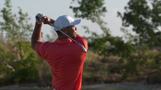 Tiger Woods warms up on the range Wednesday morning before Hero