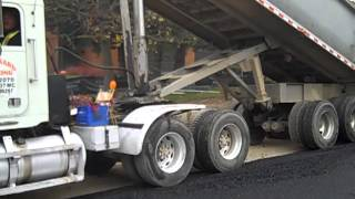 Curran asphalt: Freightliner dump truck dumping asphalt