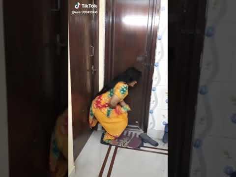 Desi Girl Peeing  At Restrooms Door