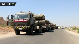 Turkish military convoy on highway in Syria after alleged airstrike