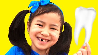 Jannie Pretend Play Loose Tooth | Funny Kid Video about The Tooth Fairy