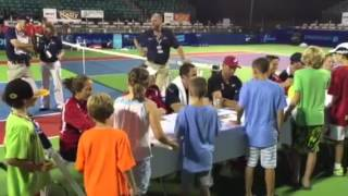 Samuel and Donald getting  Tennis Pro's autographs
