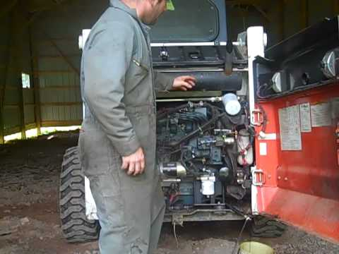 Changing Oil and Oil Filter In 763 Bobcat DIY how to video Skidsteer