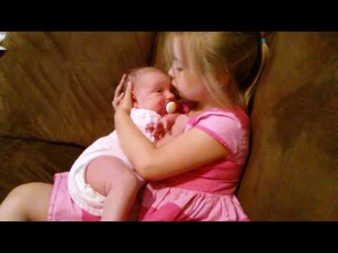 5-Year-Old Big sister gets newborn baby to sleep!