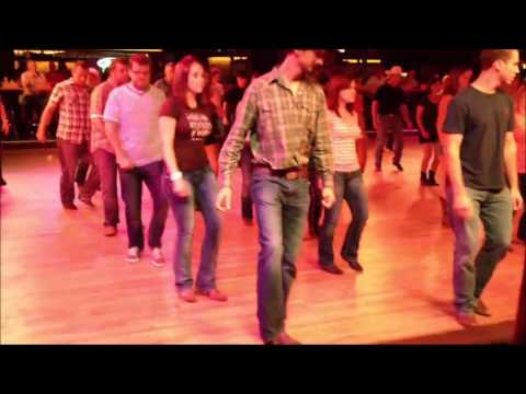 People Line Dancing to