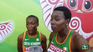 IAAF 2015 World Championships - Marie Josee Ta Lou & Murielle Ahouré after the 100m Semis