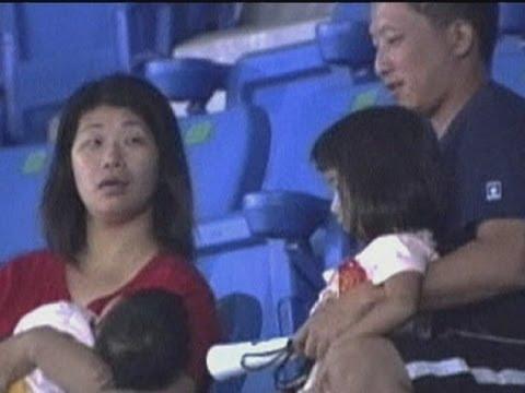 FAIL: Taiwanese man tries to catch ball … drops child