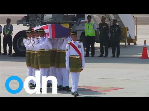 Flight MH17: Plane with Malaysian bodies arrives in Kuala Lumpur