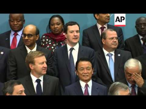 G20 finance ministers gather for family photo at IMF summit