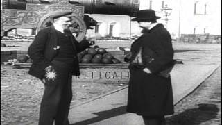 Vladimir Lenin talks to his secretary Vladimir Bonch-Bruevich besides large canno...HD Stock Footage