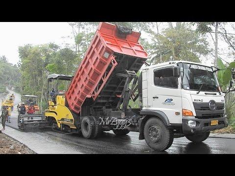 Asphalt Paver Finisher Sumitomo HA60C Working On Rainy Day