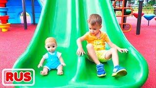 Влад и Никита играют с куклами на детской площадке