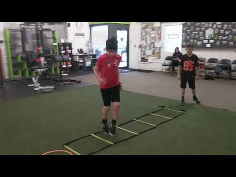 Elite Youth Athletes working on running form/technique with this lateral ladder high knee
