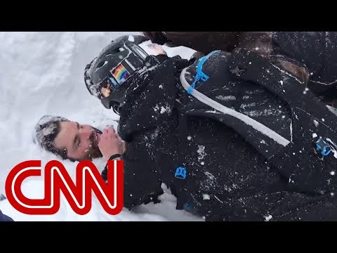 Rescuers use bare hands to dig out man buried in avalanche