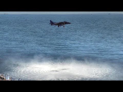 Harrier Jump Jet Performs Vertical Takeoff And Landing On Ship