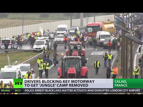 Calais chaos: Truckers driving near 'Jungle' camp violently attacked by migrants