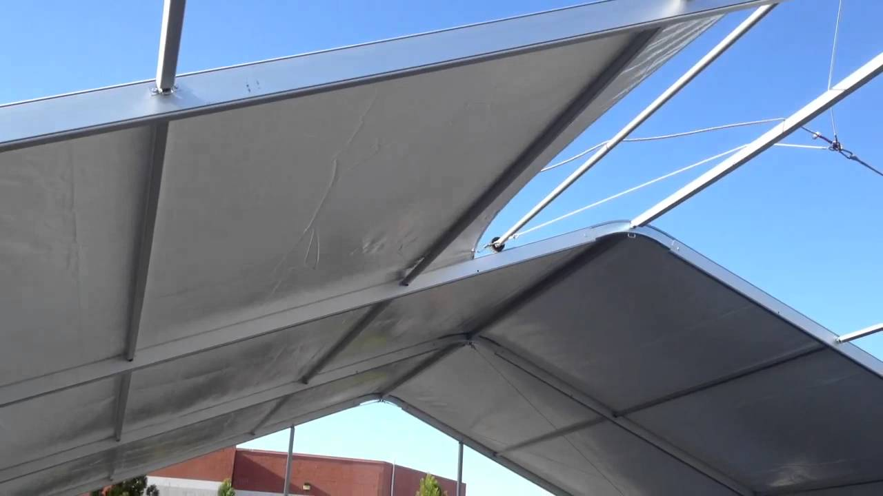 Clearspan tent top installed with a power pulley & Clearspan tent top installed with a power pulley - YouTube