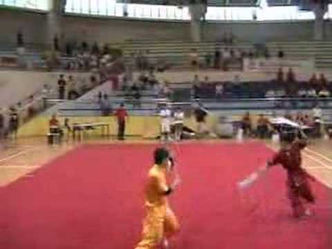 Singapore wushu double boardsword vs spear. 2005 p...