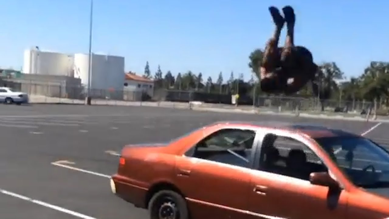 Guy flips over two cars in parking lot