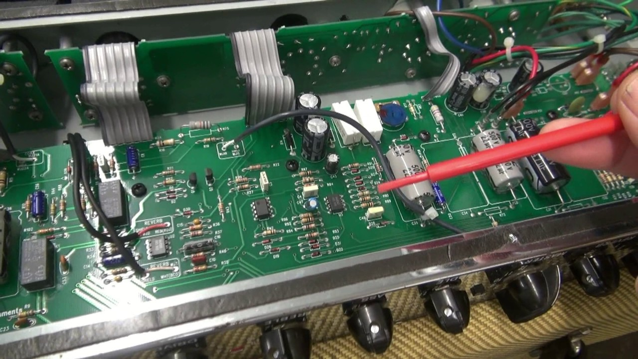 how to repair fender deluxe reissue tube guitar amp filter capacitor buzz [ 1280 x 720 Pixel ]