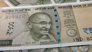 Close up shot of rotating Indian currency 500 rupee notes