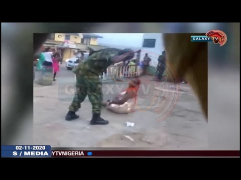 Soldiers caught on camera Ibadan flogging a woman for what they termed 'indecent dressing'