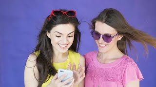 Happy Girls Using Smartphone Stock Video