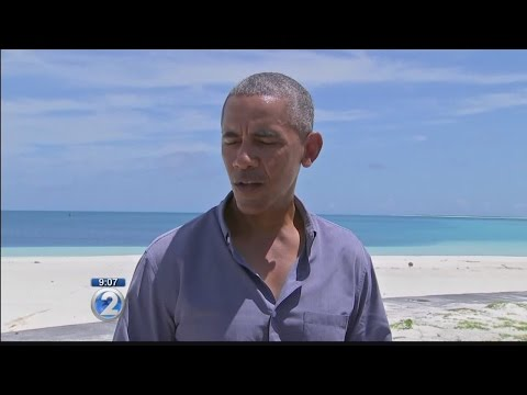 President Obama lands in Honolulu after trip to Midway Atoll