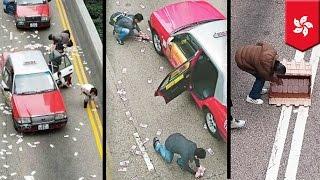 Hong Kong Xmas windfall: Armored car spills $4.5 million along a busy road in Wanchai