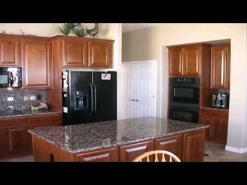 kitchen-with-white-cabinets-black-appliances---daddygif.com-(see-description)