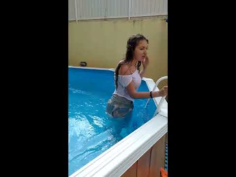 Girl trows herself at pool with clothes on